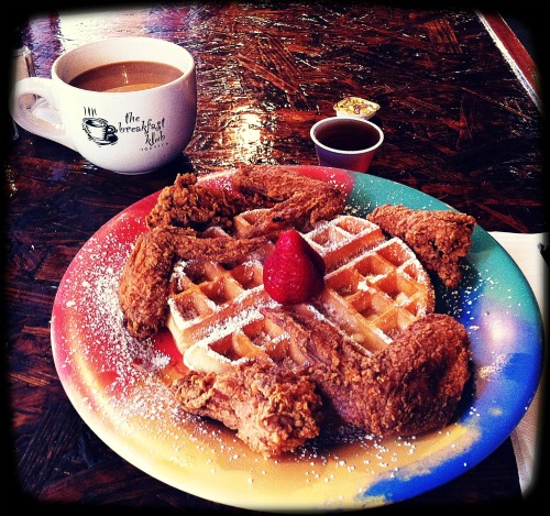 A photo of wings & waffles at The Breakfast Klub.